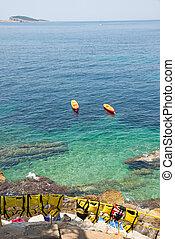Croatian coast with canoa for tourists
