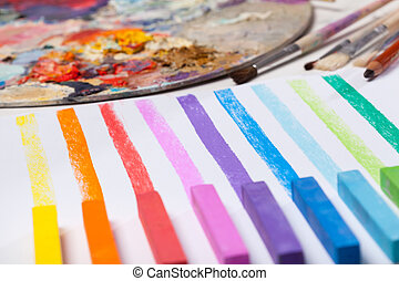 Art materials and colored lines painted in pastels