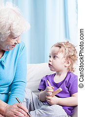 Grandma and grandson drawing together - Grandma and her...