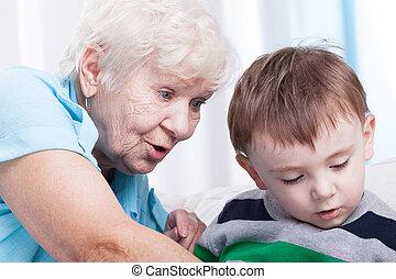 Glad grandma with little boy