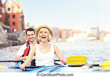 Happy tourists in a canoe - A picture of a young couple in a...