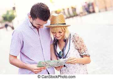 Happy tourists with a map
