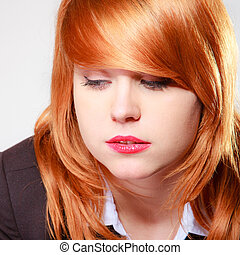 Portrait sad unhappy businesswoman. Closeup face redhaired...