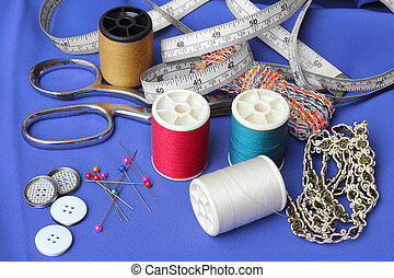 Sewing items: buttons, material, measuring tape, bobbins,...