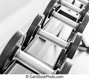 Gym equipment background with close up selective focus to a...