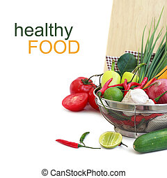 vegetables in metal colander over white with sample text