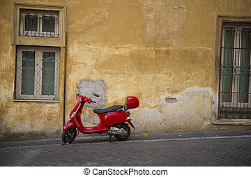 Bright red Vespa scooter in an urban street - Bright red...