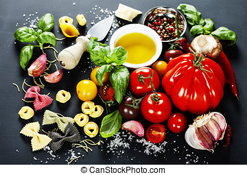 Italian ingredients - pasta, vegetables, spices, cheese - on...