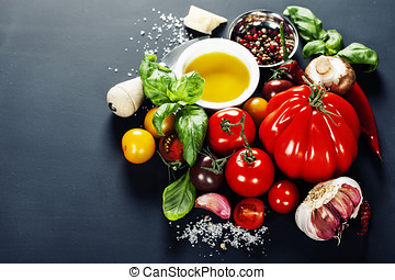 fresh vegetables - Fresh grape tomatoes with basil and...