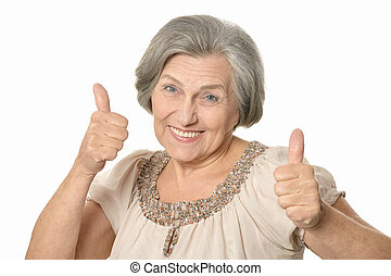 Happy elderly woman showing thymbs up isolated on white...