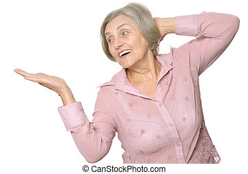 Happy elderly woman holding something isolated on white...