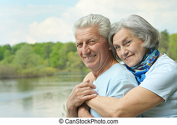 senior couple in summer - Happy senior couple in summer near...