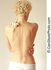 Young woman from behind, naked body, pain concept,against...