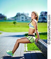 Exercise woman doing push ups in outdoor workout training...