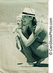 Portrait of happy loving mother and her baby at the beach...