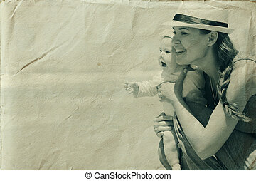 Portrait of happy loving mother and her baby at the beach....