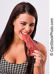 Beautiful Brunette Woman Bites Raw Red Steak Meat Eater -...