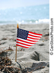 Memorial Day - A USA flag in the sand