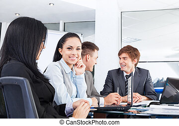 business people discussion meeting sitting at desk -...