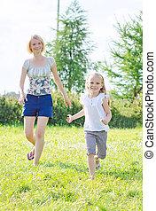 Happy family having fun at the park.