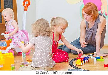 Kids playing in kindergarten