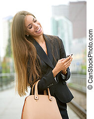 Woman sending text message on phone - Portrait of a business...