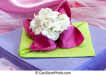 Elegant origami napkins to decorate the table on fabric...