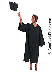 Graduate - Young woman in her graduation robes throwing her...