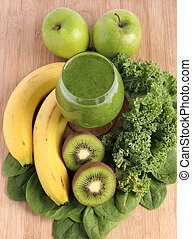 Green smoothie made with spinach, kale, kiwi, green apples...