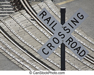 Railroad crossing - sign indicating a railroad crossing with...