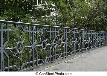 Decorative metal Fence on Bridge in the Park