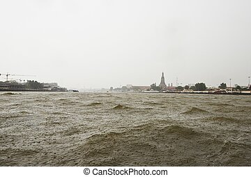 Heavy rain on Chao Phraya river in Bangkok