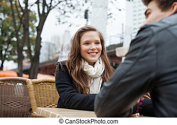 Woman With Man At Outdoor Restaurant