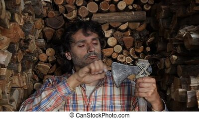 woodcutter axe - woodcutter sharpening an axe , huge...