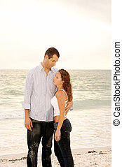 Tall man holding shorter woman - Tall handsome man looking...