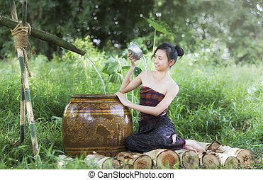 Young Asian Woman Bathing in tropical the summertime