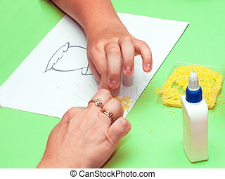 Hands that make applique - The hands of the child to get...