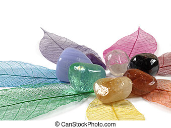 Chakra Crystals on skeleton leaves - Seven Chakra Crystals...