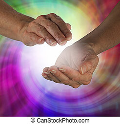 Sensing healing Energy - Female cupped hands with colorful...