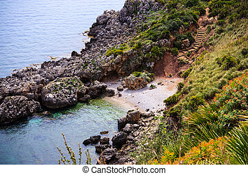 Small bay in Sicily - Stairway sloping down to the sea in...