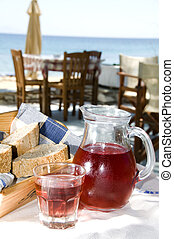 home made rose wine and crusty bread at greek island taverna