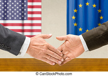 Representatives of the USA and the EU shake hands