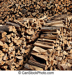 Chopped Fire Wood - Chopped fire wood stacked in a pile as a...
