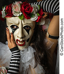 Closeup of Woman in a Jester Like Pierrot Mask - A Pierrot...