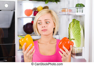 girl unhappy look red pepper, refrigerator - girl unhappy...