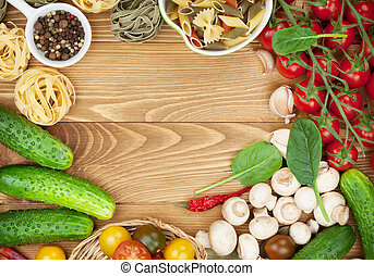 Fresh ingredients for cooking: pasta, tomato, cucumber,...
