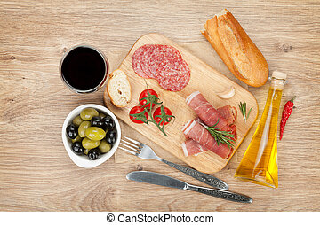 Red wine with cheese, olives, tomatoes, prosciutto, bread...