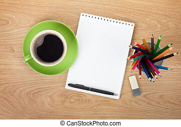 Blank notepad with office supplies and coffee cup