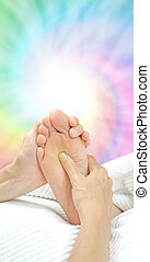 Reflexology Treatment - Reflexologist holding patient's foot...