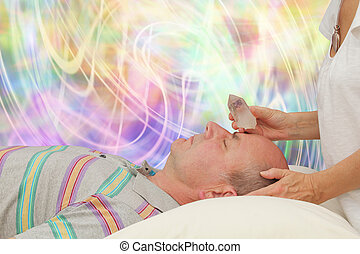Female healer and male client - Balancing Third Eye Chakra...